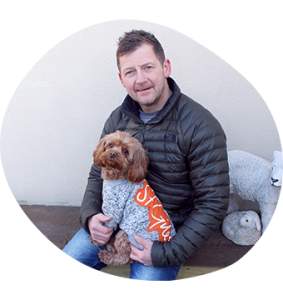 Anthony Shepherd with his dog, Lola, wearing a St Giles jumper